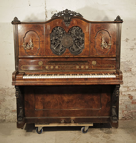 An 1866, Steingraeber upright piano with a burr walnut case and carved filgree panel with a central plaque of Beethoven