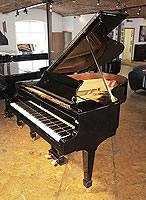 A rebuilt 1923, Steinway Model O grand piano with a black case and spade legs