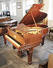 Piano for sale. 1900 Steinway Model A grand piano with a mahogany case, filigree music desk and spade legs. Cabinet features satinwood stringing inlay accents.