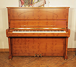 A 1999, Crown Jewels, Steinway Model K upright piano with a satin,yew case