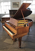 A 1922, Steinway Model O grand piano with a rosewood case and spade legs.