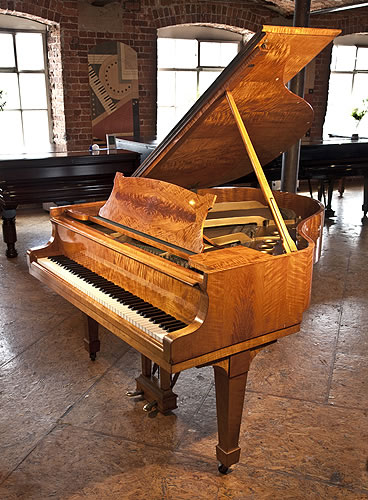 A  1936, Steinway Model S Baby Grand piano for sale with a flame maple case and spade legs