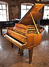 Piano for sale. A  1936, Steinway Model S baby grand piano for sale with a flame, maple case and spade legs