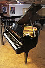 Piano for sale. A restored, 1956, Steinway Model S baby grand piano with a black case and spade legs