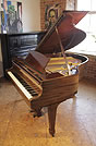 Piano for sale. A 1937, Steinway Model S baby grand piano with a mahogany case and spade legs