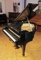 A restored, 1938, Steinway Model S baby grand piano with a black case and spade legs