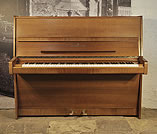 Piano for sale. A 1976, Steinway Model V upright piano with a polished, mahogany case. Piano has an eighty-eight note keyboard and two pedals