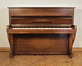 A 1954, Steinway Model Z upright piano with a mirrored, walnut case and cabriole legs. Piano has an eighty-eight note keyboard and two pedals.