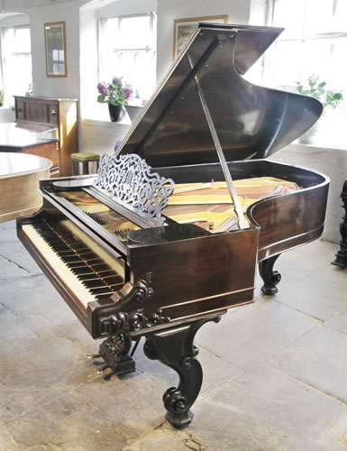 An 1877, Steinway Style 1 grand piano for sale with a rosewood case and carved Rococo style, cabriole legs