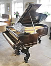 An 1877, Steinway Style 1 grand piano for sale with a rosewood case and carved Rococo style, cabriole legs.