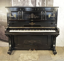 An 1883, Steinway upright piano with an ebonised case and with Neoclassical style, etched detail. Piano has an eighty-five note keyboard and two pedals. Made in New York.