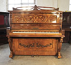 Piano for sale. A Waddington upright piano for sale with an Art Nouveau style, walnut case. Cabinet features inlaid panels of fuchsias with sinuous tendrils and carvings of foliage and flowers. Piano has an eighty-five note keyboard and two pedals.