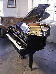 A 1994, Yamaha GH1 baby grand piano for sale with a black case and square, tapered legs. Piano has an eighty-eight note keyboard and a three-pedal lyre.
