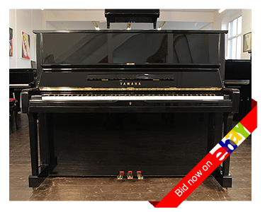 A 1974, Yamaha U1 upright piano with a  black case and brass fittings