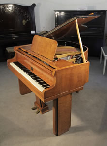 A 1939, Art Deco Allison baby grand piano with a polished satinwood case. Legs and lyre feature strong geometric styling. Piano has an eighty-five note keyboard and a two-pedal lyre.