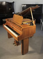 A 1939, Art Deco Allison baby grand piano with a polished satinwood case