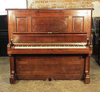 A 1923, Bechstein model 7 upright piano with a rosewood case