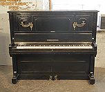 Piano for sale. A 1909, Bechstein model 8 upright piano with a black case and brass candlesticks