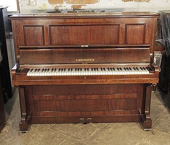 A 1924, Bechstein model 9 upright piano with a rosewood case
