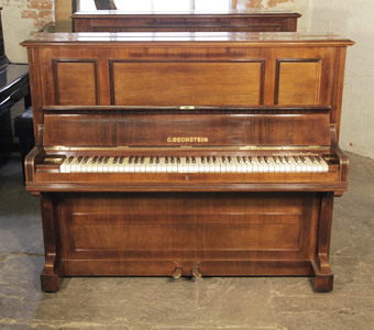 A 1909, Bechstein model 9 upright piano with a rosewood case