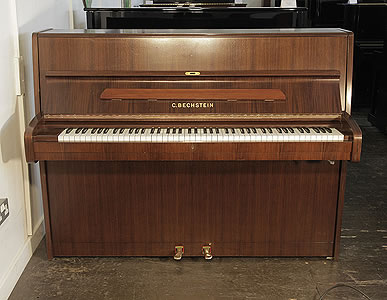 A 1988, Bechstein upright piano with a walnut case