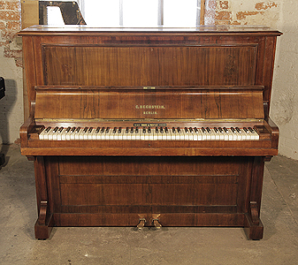 An 1890, Bechstein upright piano with a rosewood case