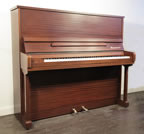 Piano for sale. A 1985, Bosendorfer upright piano with a mahogany case