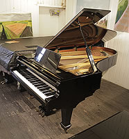A 1978, Danemann concert grand piano with a black case and spade legs