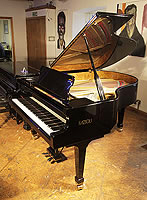 A 2011, Fazioli F183 grand piano with a black case and spade legs and fitted Pianodisc iQ Player System