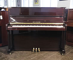 A Gors Kallmann upright piano for sale with a mahogany case