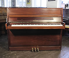A 1985, Hoffmann upright piano for sale with a walnut case
