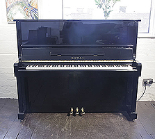 A 1985, Kawai NS-10 upright piano with a black case and polyester finish