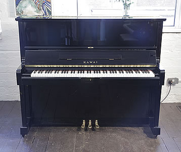 A 1991, Kawai SU-2L upright piano with a black case and polyester finish