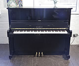 Piano for sale. A 1991, Kawai SU-2L upright piano with a black case and polyester finish