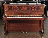 Piano for sale. A Kemble upright piano with a mahogany case and flame mahogany panel.