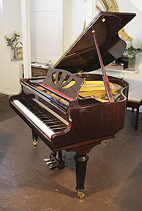 A Lothar Schell baby grand piano with a mahogany case, cut-out music desk and turned legs