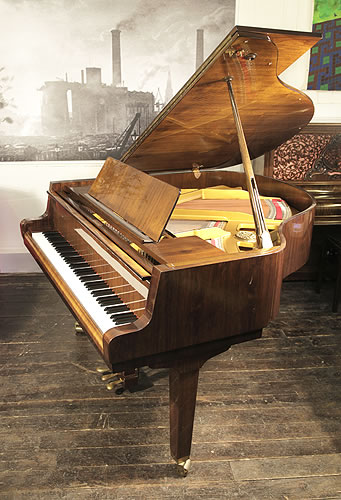 Petrof   grand Piano for sale with a walnut case.