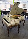 Piano for sale. A unique, 1893, Pleyel grand piano hand-painted in Berainesque style. Signed by G. Meunier. The piano cabinet features fragile architectural constructions framing central statues of Pan or nudes. Colourfully attired figures such as animal tamers, dancers characters from the Commedia dell Arte also feature. Typical motifs of mythical creatures, birds, flowers, swags, scrolls, acanthus and crested composers names also adorn the cabinet. Berain's Singerie (monkeys) feature here and are illustratrative of a new design element to become highly fashionable during the Rococo period. There are numerous carved features; the piano cheeks are carved with fish whilst a lion's head appears on the lid lock. The lid also has a carved bevelled edge in a foliage design. The piano case sits on ornately carved french walnut frame, carved with foliage and flowers. Piano has six cabriole legs with scroll feet. Instrument has been restored