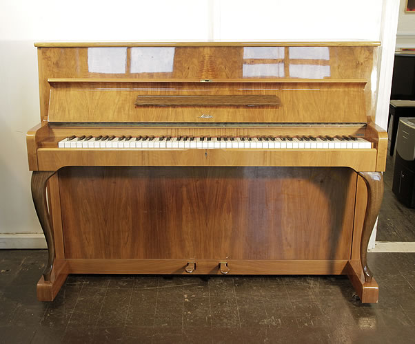 Sauter upright Piano for sale with a   walnut case.