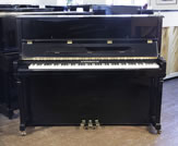 Piano for sale. A Schiedmayer E-118 Upright Piano For Sale with a Black Case and Brass Fittings