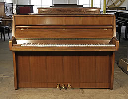 A 1960, Schimmel upright piano with a mahogany case