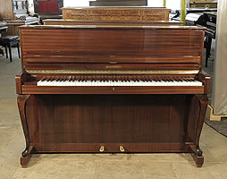 A 1961, Schimmel upright piano with a mahogany case and cabriole legs