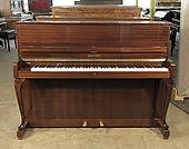 Piano for sale. A 1961, Schimmel upright piano with a mahogany case and cabriole legs