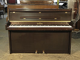 A 1964, Schimmel upright piano with a mahogany case