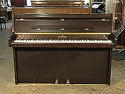 Piano for sale. A 1964, Schimmel upright piano with a mahogany case