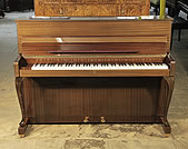 Piano for sale. A 1964, Schimmel upright piano with a mahogany case and cabriole legs