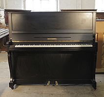 A modernised, 1930,Schimmel upright piano with a satin, black case and cabriole legs
