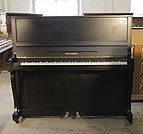 Piano for sale. A modernised, 1930, Schimmel upright piano with a satin, black case and cabriole legs