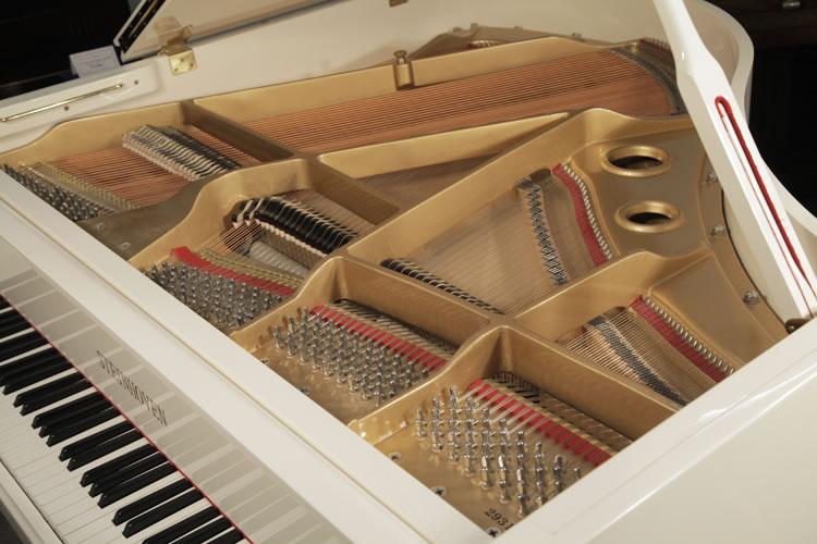White Steinhoven  Model 148 Baby Grand Piano for sale.