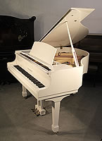 Nearly New, Steinhoven Model 148 Baby Grand Piano For Sale with a White Case and Spade Legs